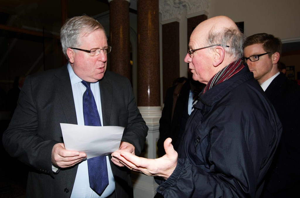 Derrick Coffee of Campaign for Better Transport - East Sussex button-holes Secretary of State for Transport, Patrick McLoughlin MP in Eastbourne